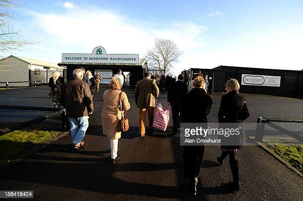 Racegoers make their way to the entrance during the last meeting to be held at Hereford racecourse after 241 years of racing on December 16 2012 in...