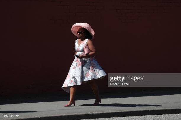 Racegoers make their way to the entrance on the third day of the Royal Ascot horse racing meet in Ascot west of London on June 21 2018 The fiveday...