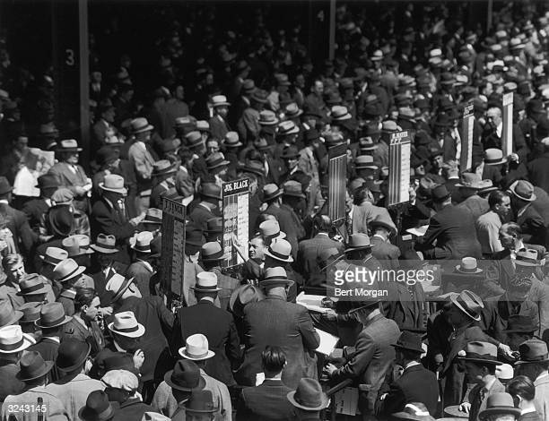 Racegoers place their bets with bookmakers at Belmont Park Racetrack New York