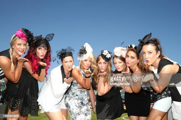 Racegoers pose for a photo on Victoria Derby Day at Flemington Racecourse on November 2 2013 in Melbourne Australia