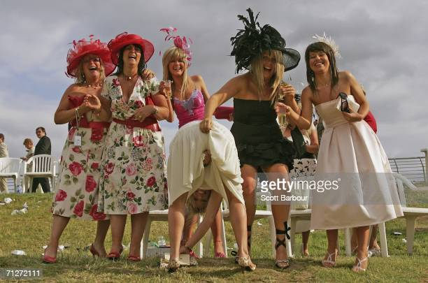 Race-goers pose for a photograph as they make their way home after Ladies' Day, the third day of Royal Ascot, at the Ascot Racecourse on June 22,...