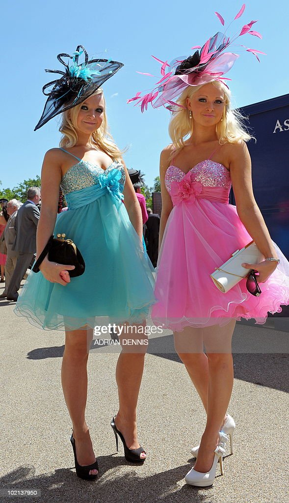 Racegoers pose for a photograph during the second day of Royal Ascot, in Berkshire, west of London, on June 16, 2010. The five-day meeting is one of the highlights of the horse racing calendar. Horse racing has been held at the famous Berkshire course since 1711 and tradition is a hallmark of the meeting. Top hats and tails remain compulsory in parts of the course while a daily procession of horse-drawn carriages brings the Queen to the course.