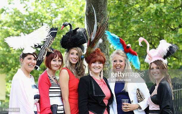 Racegoers pose for a photograph on Ladies Day at Royal Ascot at Ascot Racecourse on June 14 2011 in Ascot United Kingdom