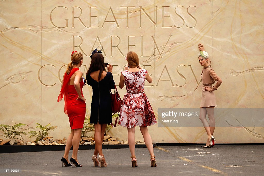Racegoers pose for photos during Oaks Day at Flemington Racecourse on November 7, 2013 in Melbourne, Australia.
