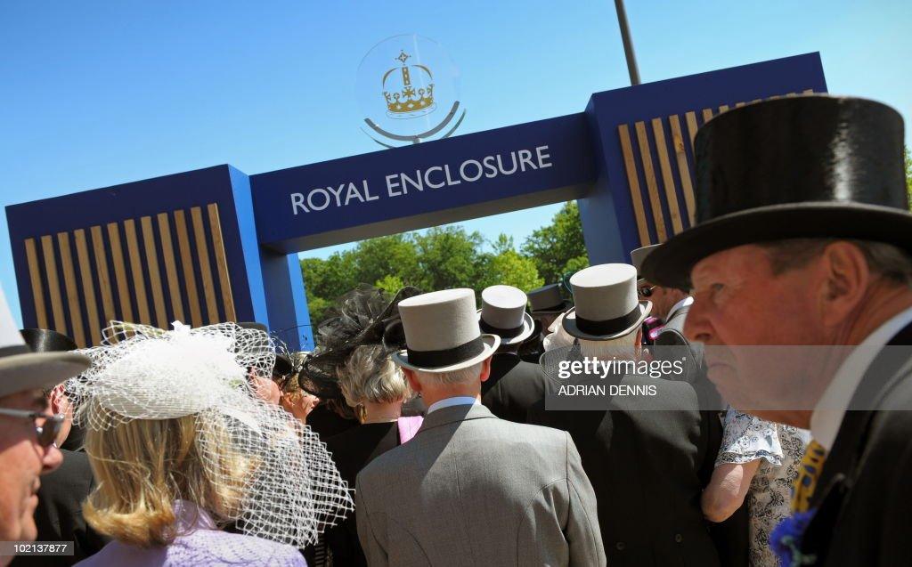 Racegoers queue for a position in the Royal Enclosure on the second day of Royal Ascot, in Berkshire, west of London, on June 16, 2010. The five-day meeting is one of the highlights of the horse racing calendar. Horse racing has been held at the famous Berkshire course since 1711 and tradition is a hallmark of the meeting. Top hats and tails remain compulsory in parts of the course while a daily procession of horse-drawn carriages brings the Queen to the course.