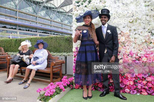 Britain's Mo Farah and his wife Tania pose as they arrive on the second day of the Royal Ascot horse racing meet in Ascot west of London on June 20...
