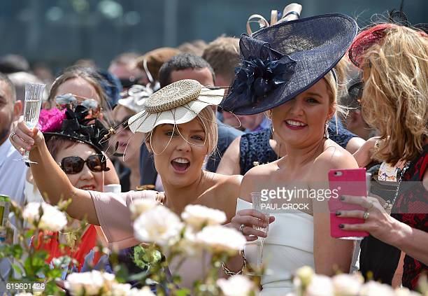 Racegoers react as the horses prepare to take to the track for the 156th running of the Melbourne Cup at Flemington Racecourse in Melbourne on...