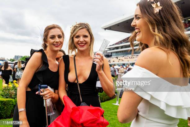 Race-goers react as they are photographed during 2019 Derby Day at Flemington Racecourse on November 2, 2019 in Melbourne, Australia.