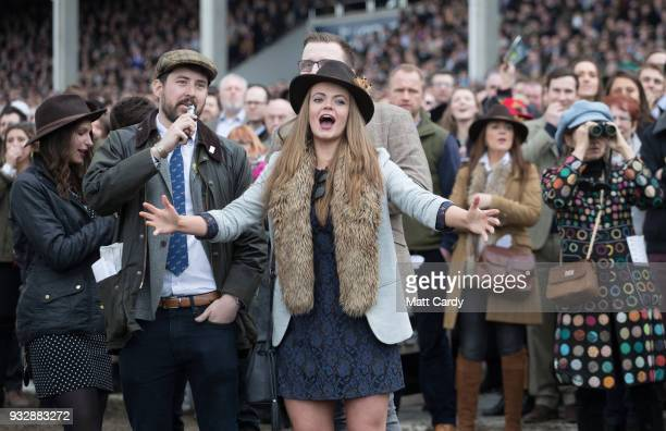 Racegoers react as they watch the racing in the Gold Cup at Cheltenham Racecourse on Gold Cup Day on March 16 2018 in Cheltenham England Thousands of...
