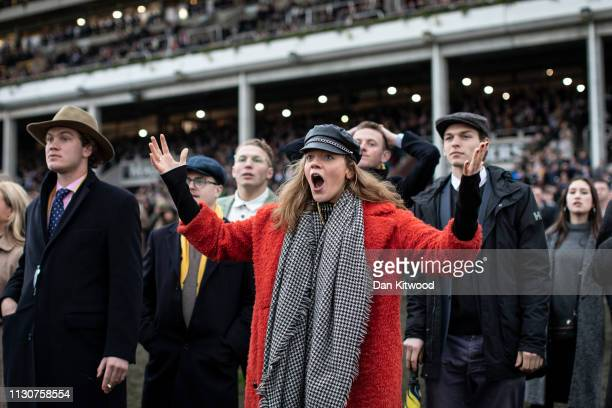 Racegoers react during the seventh and final race the 'Martin Pipe Conditional Jockeys' Handicap Hurdle' during Gold Cup Day at Cheltenham Festival...