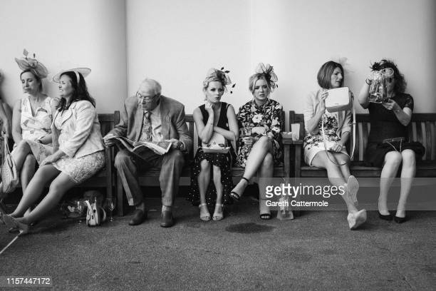 Racegoers relax between races on day three of Royal Ascot at Ascot Racecourse on June 20, 2019 in Ascot, England.