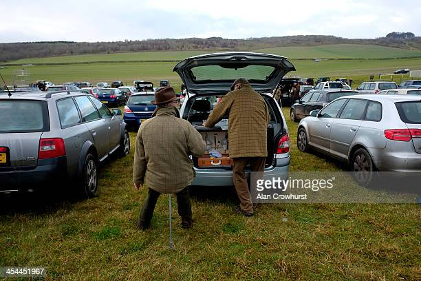 Racegoers relax in the car park before racing during the point to point meeting at Barbury Castle racecourse on December 08 2013 in Swindon England