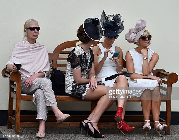 Racegoers relax on a bench on the first day of the annual Royal Ascot horse racing event near Windsor west of London on June 16 2015 AFP PHOTO / BEN...