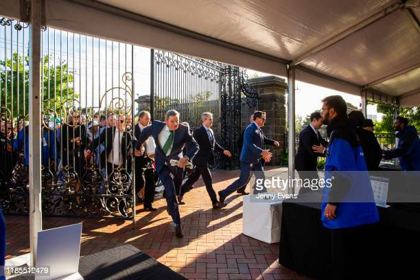 Race-goers run as the gates are opened during 2019 Melbourne Cup Day at Flemington Racecourse on November 05, 2019 in Melbourne, Australia.
