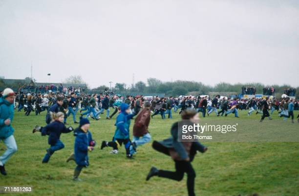 Racegoers run onto the track in the chaos that ended the Grand National at Aintree Racecourse Liverpool 3rd April 1993 The race was declared void...