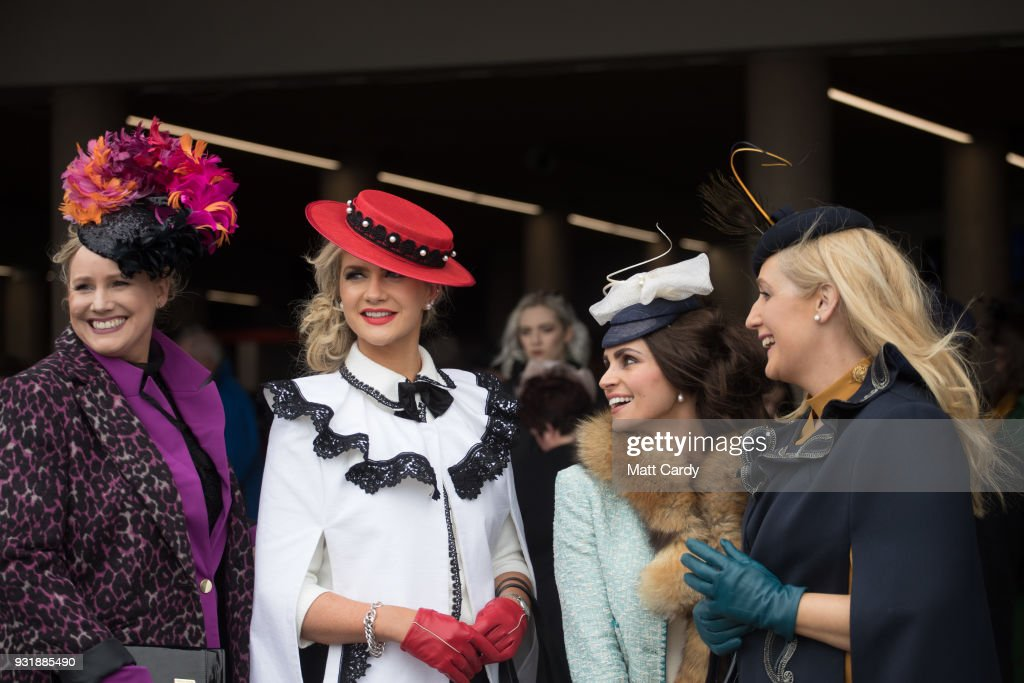 Racegoers share a joke as they arrive for Ladies Day at Cheltenham Racecourse on March 14, 2018 in Cheltenham, England. Thousands of racing enthusiasts are expected at the four-day festival in Gloucestershire which opened yesterday.