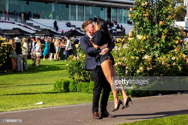 Race-goers share a kiss after the 2019 Melbourne Cup Day at Flemington Racecourse on November 05, 2019 in Melbourne, Australia.