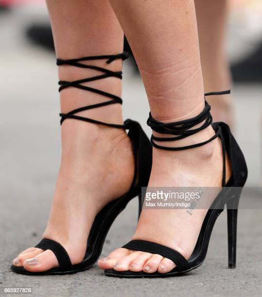 A Racegoer's shoe and tattoo detail seen on day 2 'Ladies Day' of the Randox Health Grand National Festival at Aintree Racecourse on April 7 2017 in...