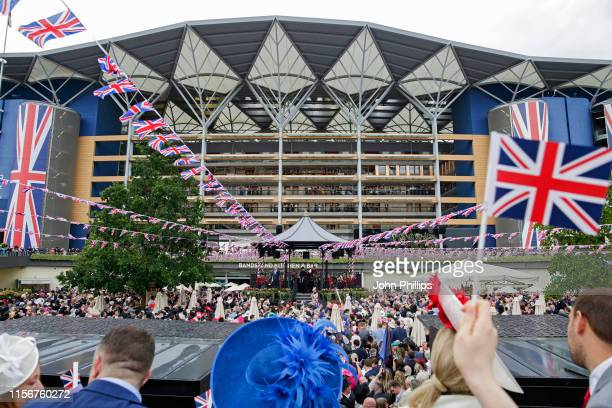 Racegoers sing around the bandstand on day 1 of Royal Ascot at Ascot Racecourse on June 18, 2019 in Ascot, England.