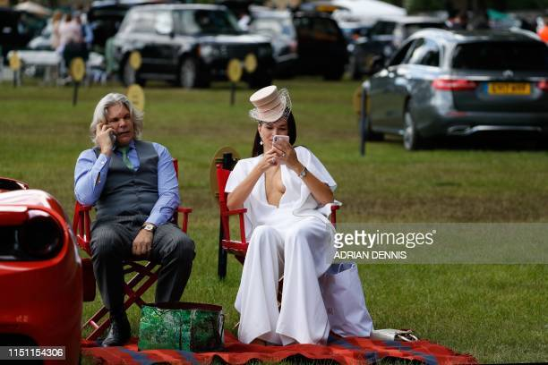 Racegoers sit in the car park as they attend day four of the Royal Ascot horse racing meet in Ascot west of London on June 21 2019 The fiveday...