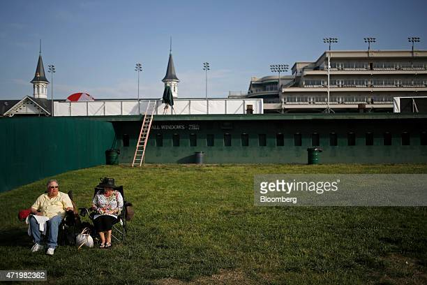 Racegoers sit in the infield at Churchill Downs on the morning of the 141st Kentucky Derby in Louisville Kentucky US on Saturday May 2 2015 The 141st...