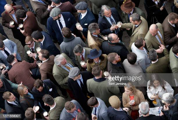 Racegoers socialising during day four of the Cheltenham National Hunt Racing Festival at Cheltenham Racecourse on March 13th 2020 in Gloucestershire