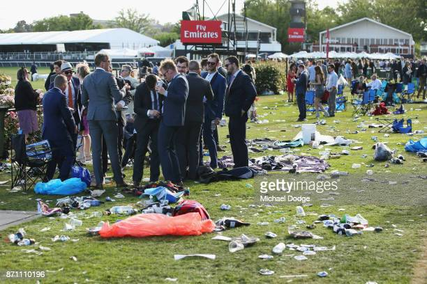 Racegoers stay around after the last race during Melbourne Cup Day at Flemington Racecourse on November 7 2017 in Melbourne Australia