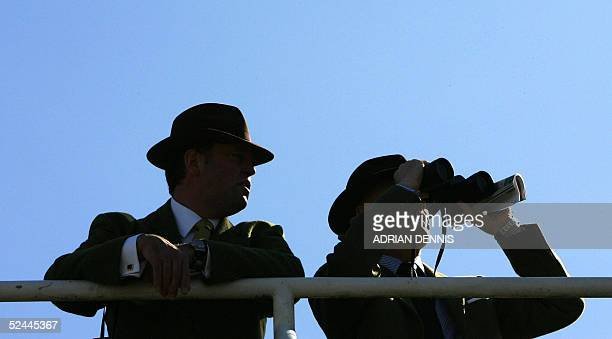 Racegoers survey the crowd before the start of the horse races at the Cheltenham Festival 18 March 2005. The four-day festival culminates with the...