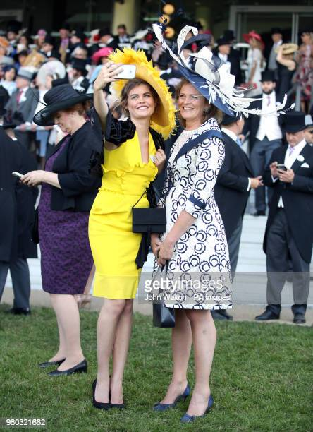 Racegoers take a selfie during day three of Royal Ascot at Ascot Racecourse.