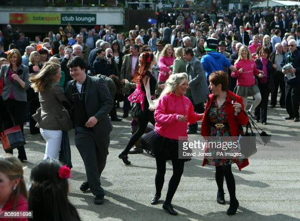 Racegoers take part in an impromptue ceilidh during St Patrick's Day at Cheltenham Racecourse