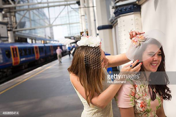 Racegoers travel by train from Waterloo station for Ladies Day at the Royal Ascot race meeting on June 19 2014 in London England The Royal Ascot...