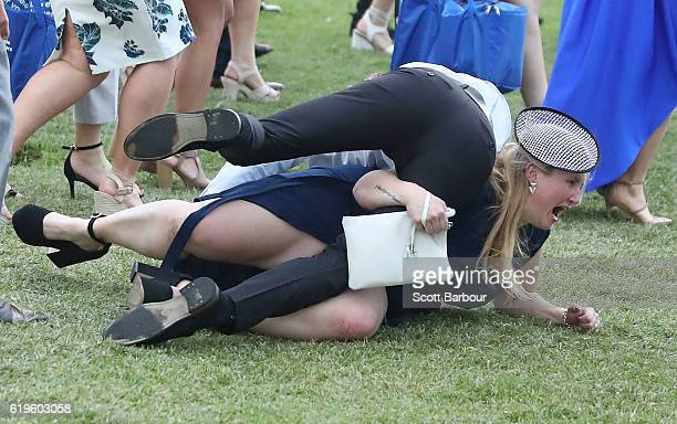 Racegoers trip over each other following 2016 Melbourne Cup Day at Flemington Racecourse on November 1 2016 in Melbourne Australia