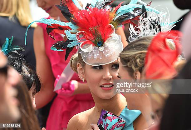 Racegoers wait to compete in the 'Fashion on the Field' competition during Melbourne Cup festivities at Flemington Racecourse in Melbourne on...