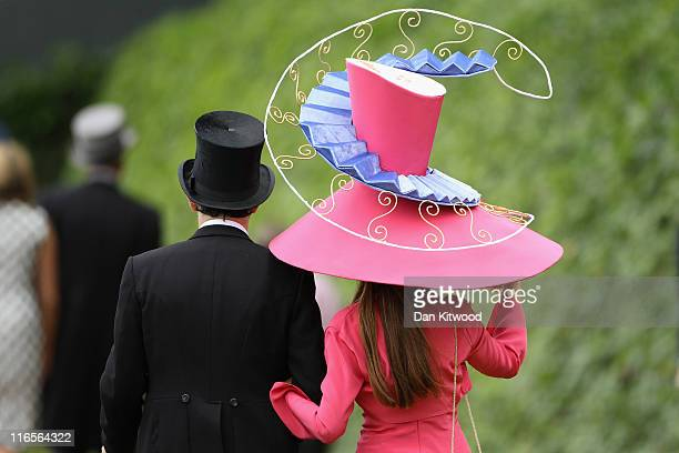 Racegoers walk by the racecourse on Ladies Day at Royal Ascot on June 16, 2011 in Ascot, England. The five-day meeting is one of the highlights of...