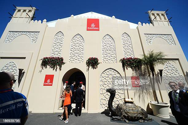 Racegoers walk past the Emirates Airline marquee in the Birdcage enclosure on Melbourne Cup Day at Flemington Racecourse in Melbourne Australia on...