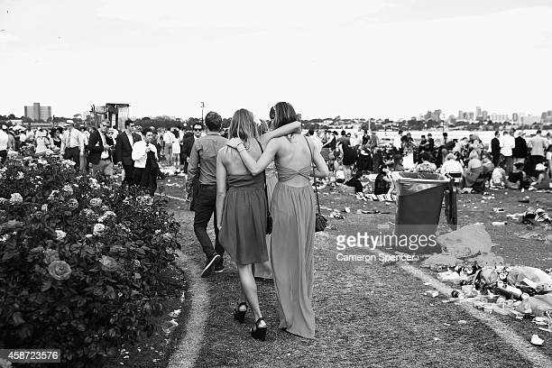 Racegoers walk trhough the public area on Melbourne Cup Day at Flemington Racecourse on November 4 2014 in Melbourne Australia