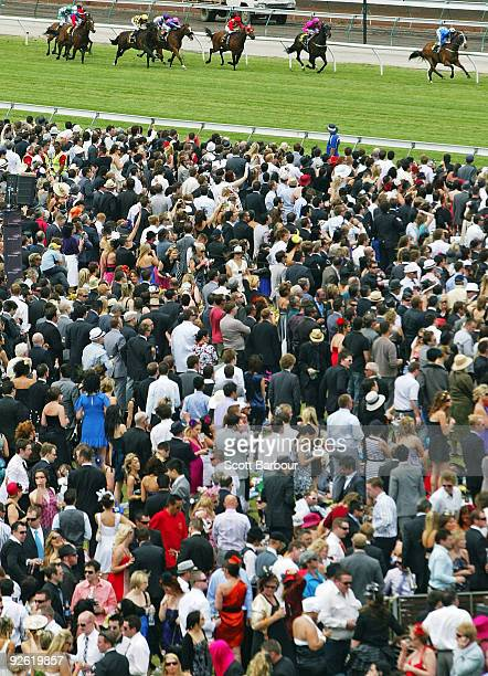 Racegoers watch a race during the 2009 Melbourne Cup Day meeting at Flemington Racecourse on November 3 2009 in Melbourne Australia