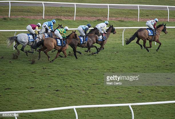 Racegoers watch a race during the 2016 Coral Welsh Grand National at Chepstow Racecourse on December 27 2016 in Chepstow Wales Traditionally the...