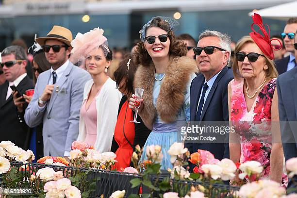 Racegoers watch a race on Melbourne Cup Day at Flemington Racecourse on November 1 2016 in Melbourne Australia