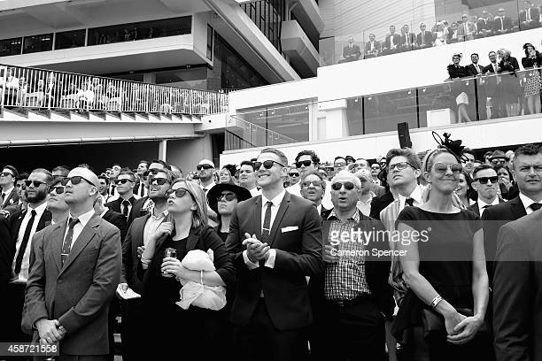 Racegoers watch a race on Victoria Derby Day at Flemington Racecourse on November 1 2014 in Melbourne Australia