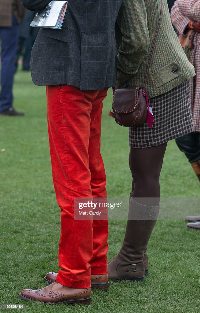 Racegoers watch as horses are paraded in the paddock on the second day of the Cheltenham Festival on March 11, 2015 in Cheltenham, England.