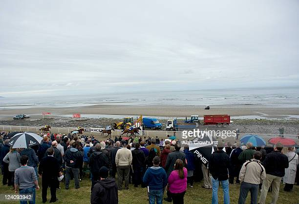 Racegoers watch from the bank during the Laytown race meeting run on the beach on September 08 2011 in Laytown Ireland