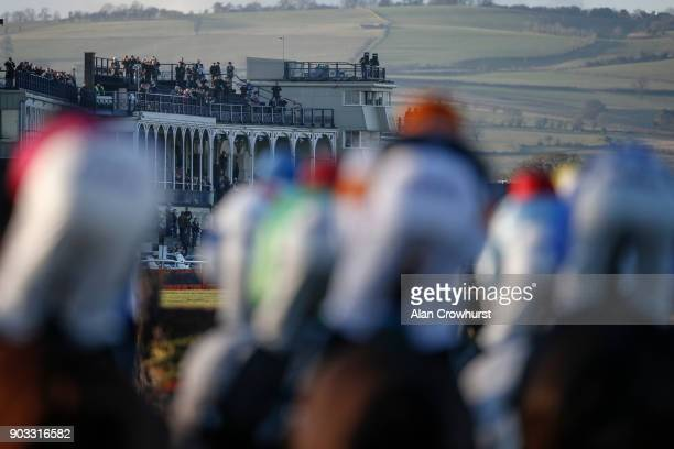Racegoers watch from the grandstands as runners turn into the straight at Ludlow racecourse on January 10 2018 in Ludlow England