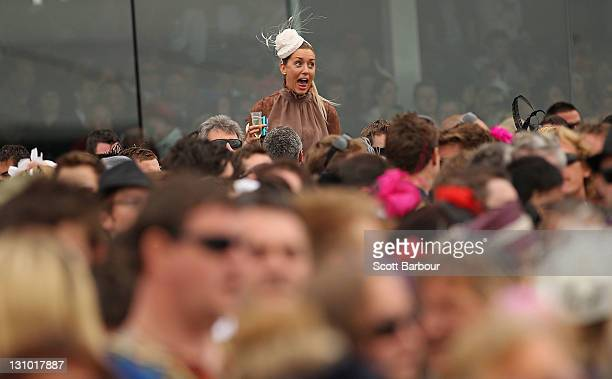 Racegoers watch Race 7 the Emirates Melbourne Cup during Melbourne Cup Day at Flemington Racecourse on November 1 2011 in Melbourne Australia