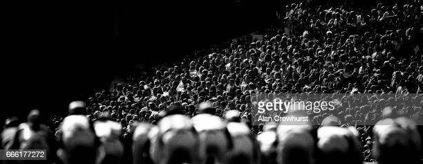 Racegoers watch the action at Aintree Racecourse on April 8 2017 in Liverpool England