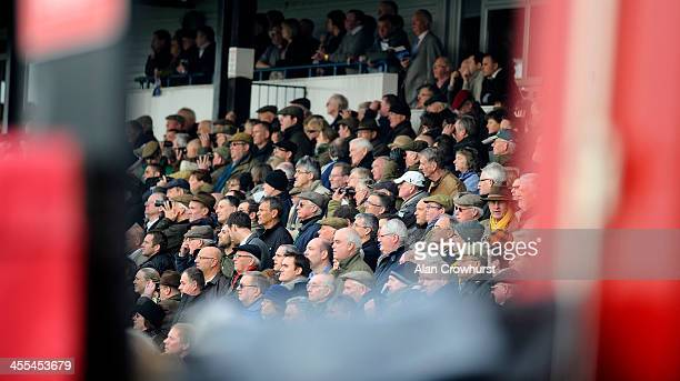 Racegoers watch the action at Huntingdon racecourse on December 12 2013 in Huntingdon England