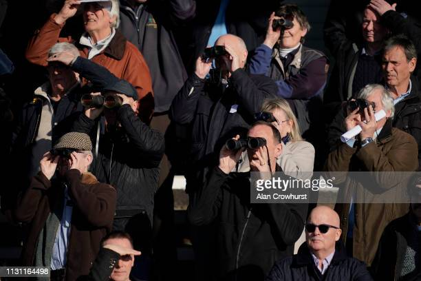 Racegoers watch the action at Huntingdon Racecourse on February 21 2019 in Huntingdon England