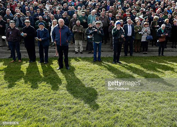 Racegoers watch the action at Punchestown racecourse on April 26 2016 in Naas Ireland