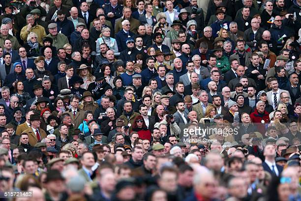 Racegoers watch the action during the Stan James Champion Hurdle Challenge Trophy Race on day one Champion Day of the Cheltenham Festival at...