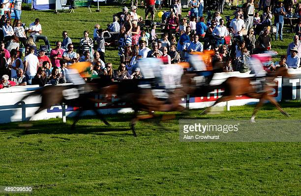 Racegoers watch the action from the centre of the course at Plumpton racecourse on September 20 2015 in Plumpton England